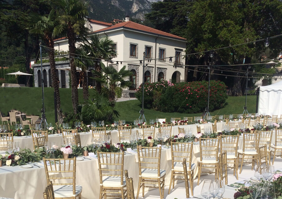 Lake-Como-Villa-Lario-outdoor-wedding-dining-with-canopy-of-festival-market-lights