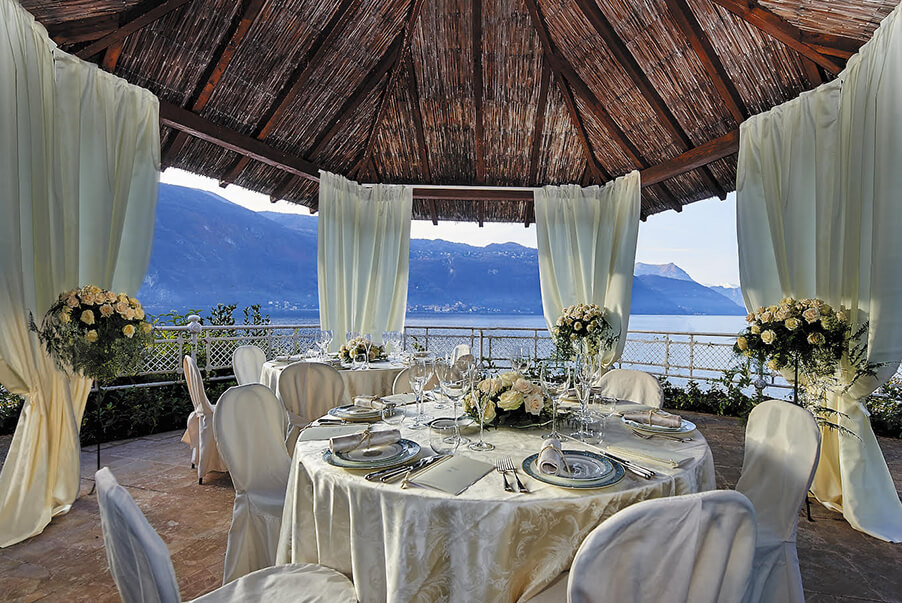 villa-lario-resort-wedding-venue-dining-in-the-gazeebo-in-front-of-Lake-Como