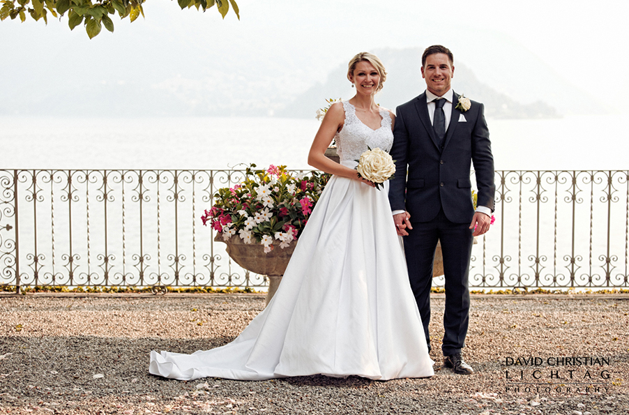 bride-and-groom-posing-for-a-photo-at-Vlla-Cipressi