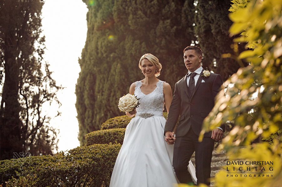 Bride-and-groom-walking-in-the-gardens-at-Villa-Cipressi-on-Lake-Como