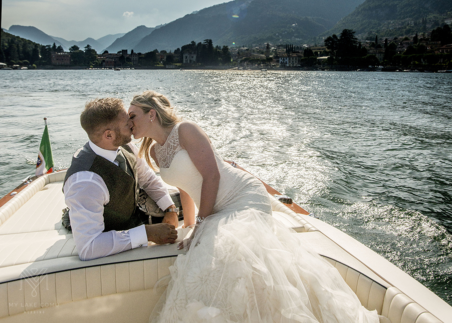 Bride-groom-kissing-on-speed-boat-during-thier-Laake-Como-wedding