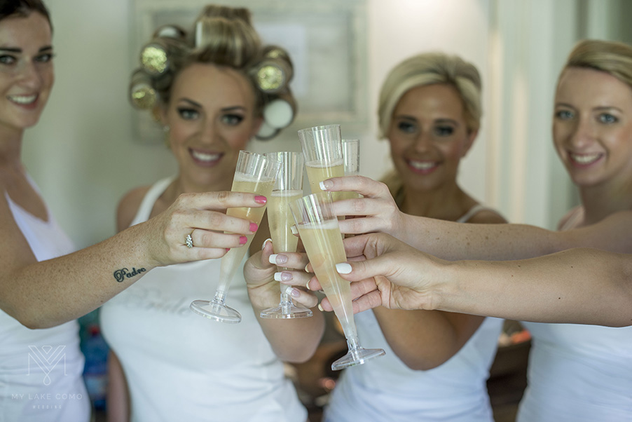 Bride-and-her-bridesmaids-cllebrating-with-champagne-on-Lake-Como
