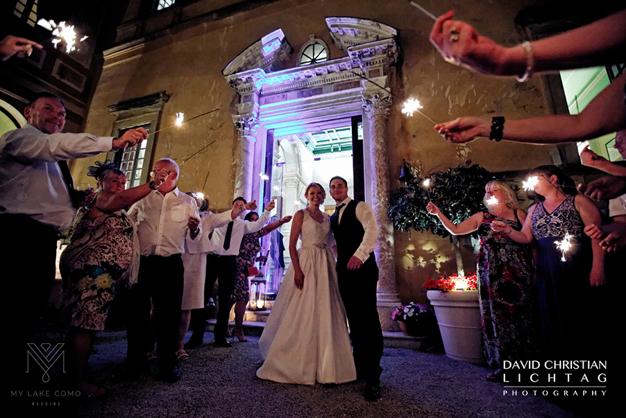 Bride-and-groom-with-sparklers-outdoor-Lake-Como-wedding-at-Villa-Cipressi-in-Varenna-town