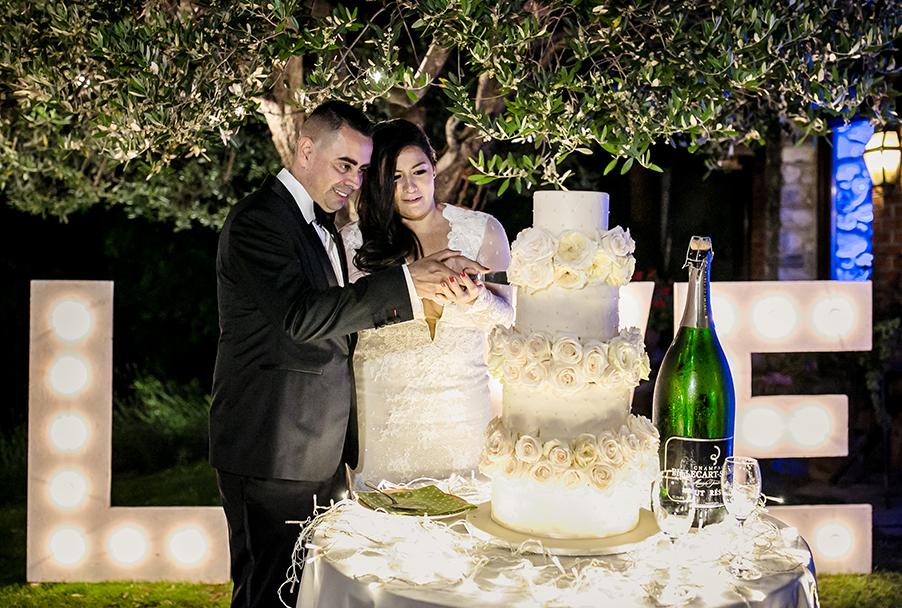 bride-and-groom-cut-the-four-tier-wedding-cake-at-italian-villa-by-my-lake-como-wedding