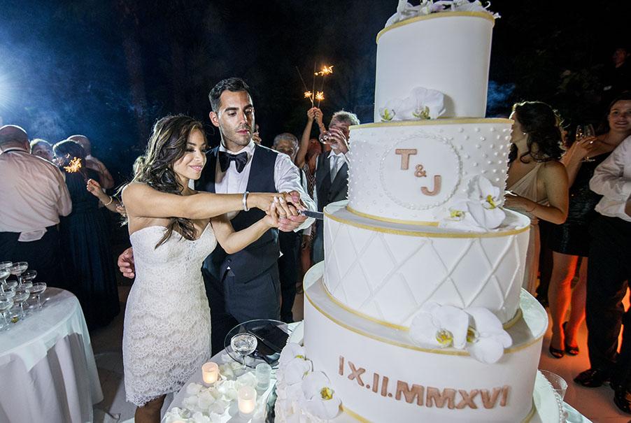 bride-and-groom-cut-the-wedding-cake-on-lake-como-by-my-lake-como-wedding