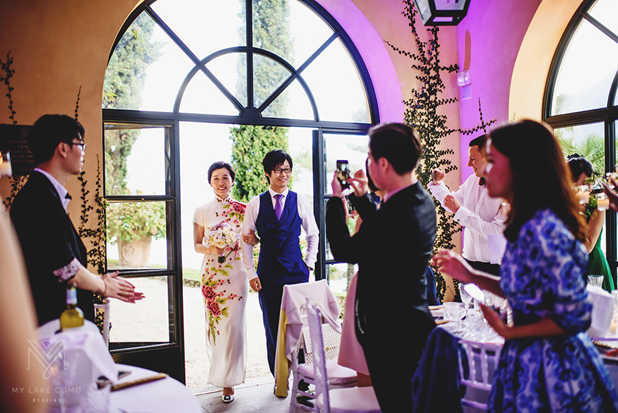 bride-and-groom-enter-the-wedding-dining-room-at-Lake-Como-Villa-Balbianello