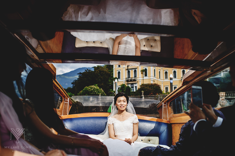 Bride-on-her-bridal-speed-boat-on-Lake-Como