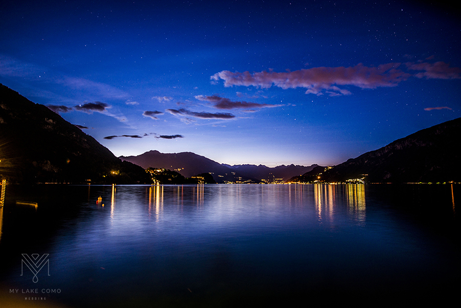 Lake-Como-at-night-with-reflection-of-villa-lights-and-stars