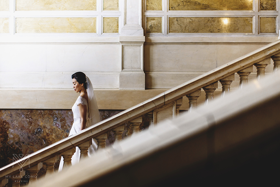 Lake-Como-bride-walking-down-the-stairs-at-Grand-Hotel-Serbelloni