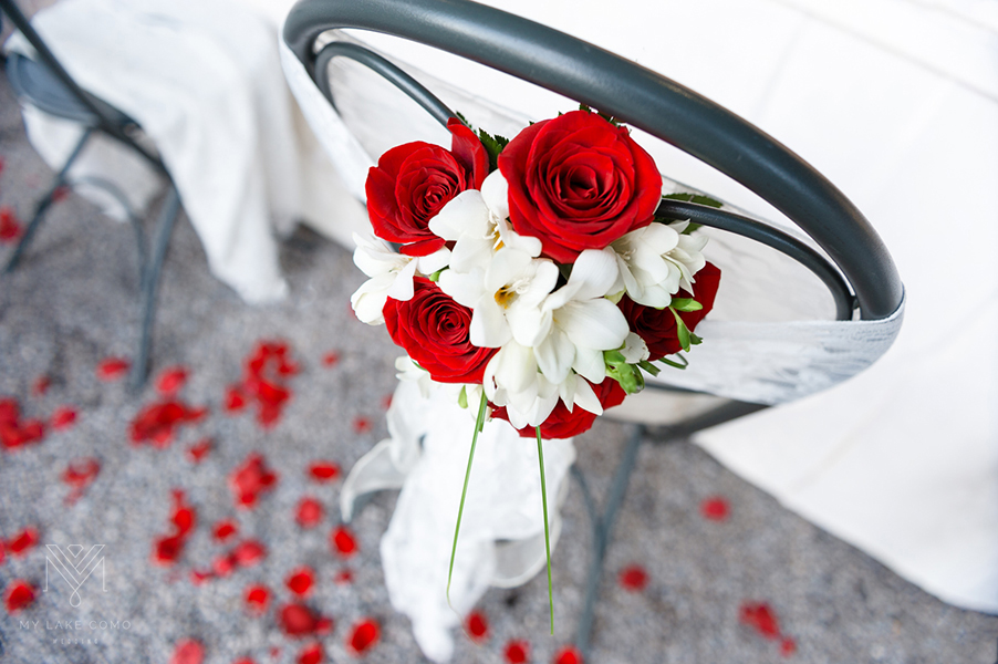 Lake-Como-wedding-red-rose-dining-chair-bouquet