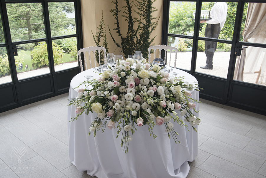 Villa-Balbianello-wedding-bride-and-groom-table-flower-spray-display