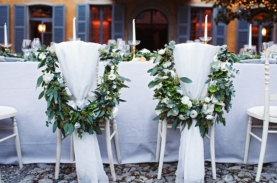 wedding-bride-and-groom-flower-decorated-chiars-at-villa-teodolinda-by-my-lake-como-wedding