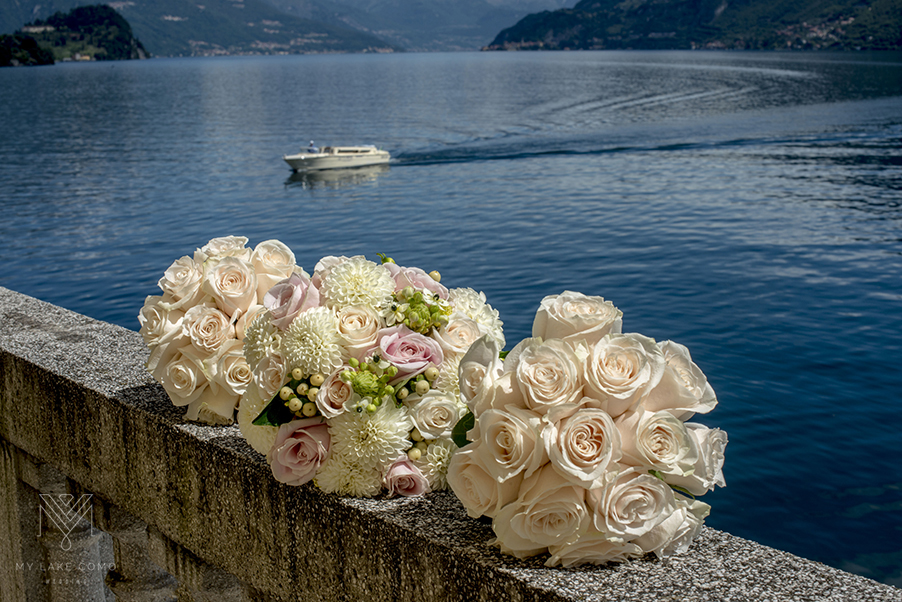 Wedding-bridal-party-flower-bouquets-on-wall-on-Lake-Como