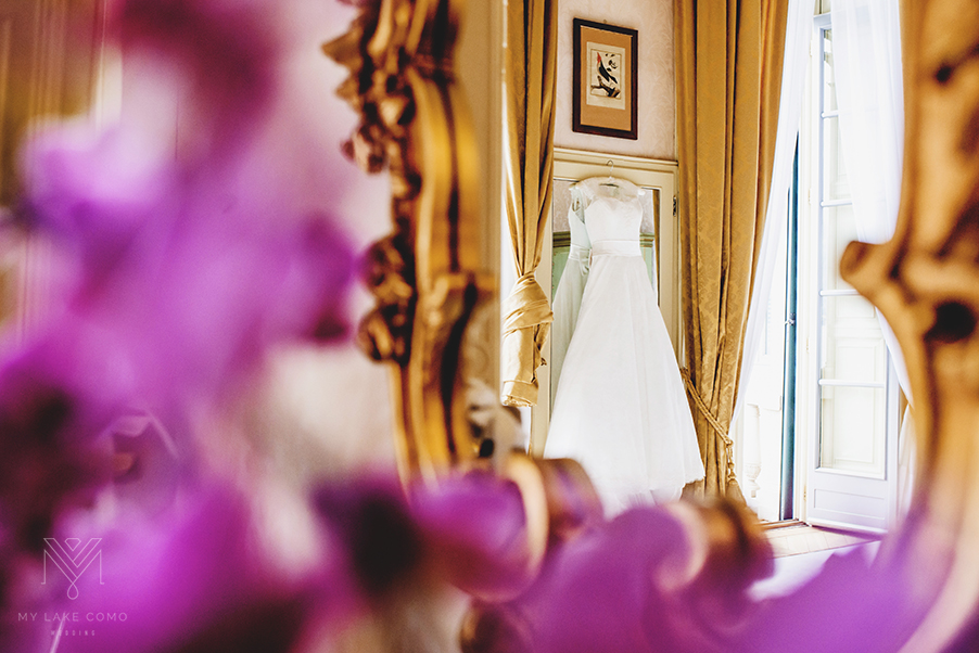 Wedding-dress-hanging-in-Grand-Hotel-Serbelloni-bedroom-Lake-Como