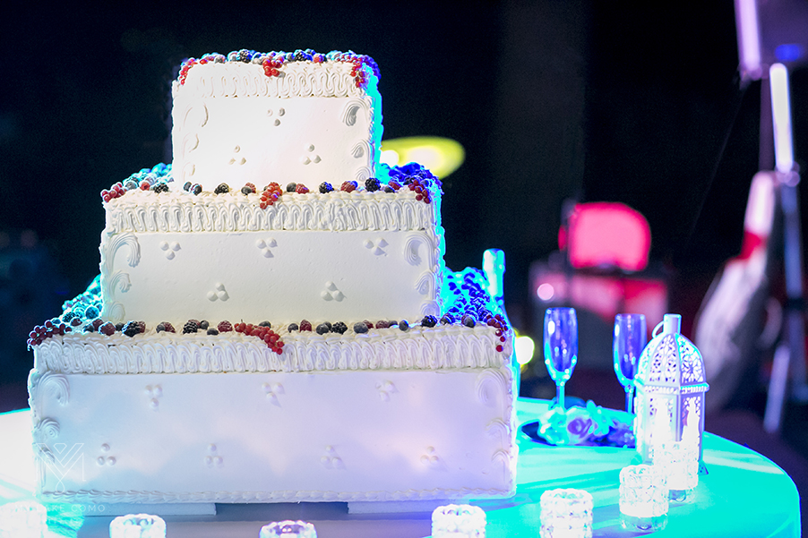 three-tier-wedding-cake-with-white-icing-and-fruit