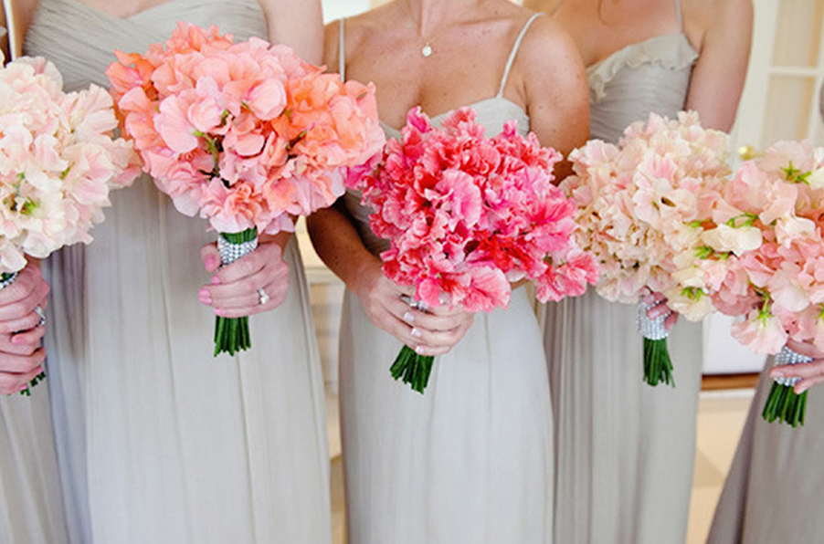 Sweet-pea-lathyrus-odoratus-fabaceae-hand-wedding-bouquet-in-coral-pink-ivory-and-orange-lake-como