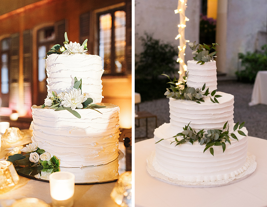 Two-wedding-cakes-at-a-wedding-on-Lake-Como-with-candles-and-olive-leaf-flowers