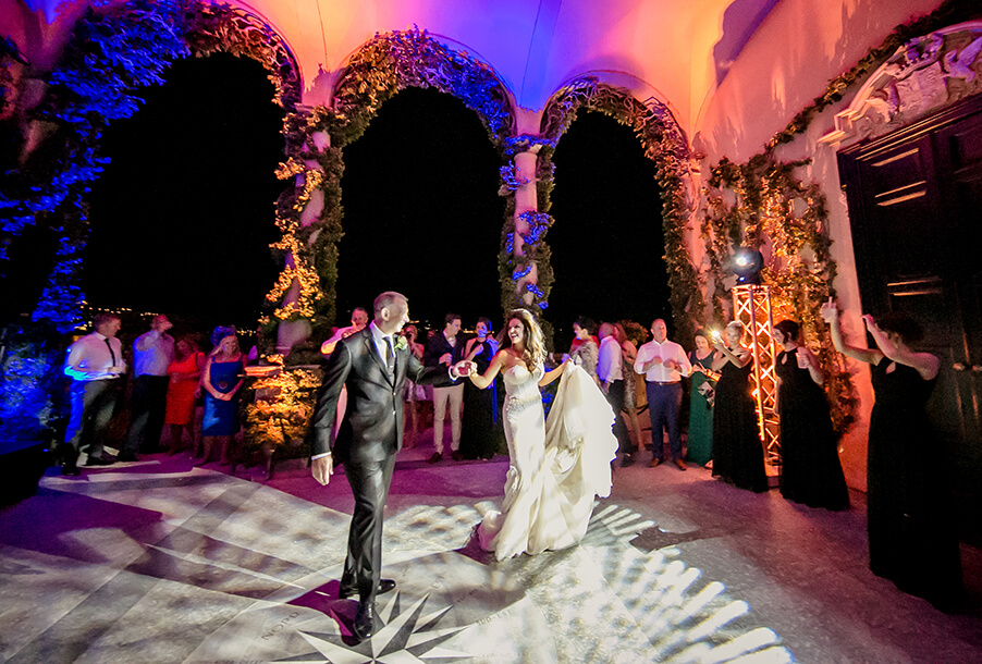 bride-and-groom-first-dance-in-italian-villa-with-lighting-by-my-lake-como-weding