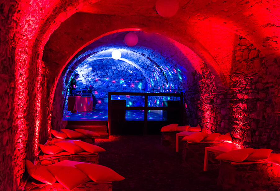 disco-lighting-and-red-mood-lights-for-wedding-danscing-in-a-villa-cellar-at-villa-monastero-my-lake-como-wedding