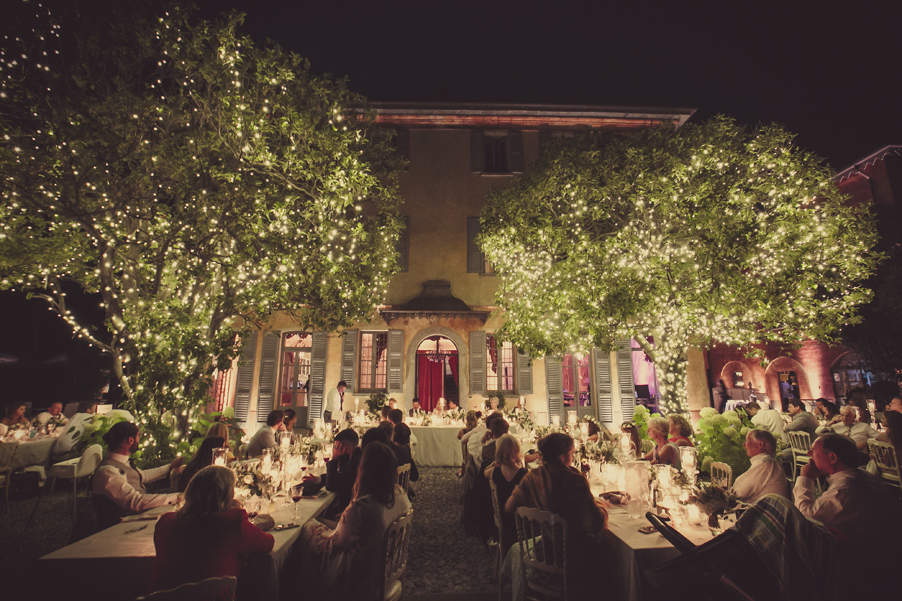 Wedding-day-dining-terrace-lighting-in-the-trees-and-above-tables