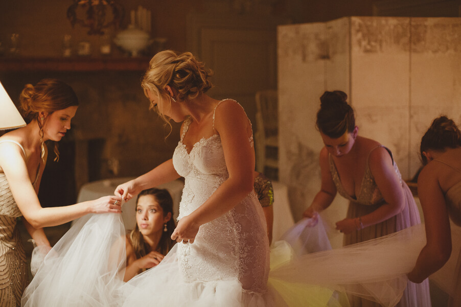Bride-getting-ready-with-her-bridesmaids-in-wedding-dress-in-Italian-villa