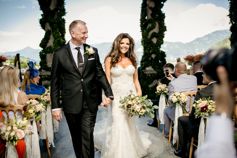 Bride-smiles-as-she-leaves-ceremony-terrace-wedding-by-My-Lake-Como-Wedding