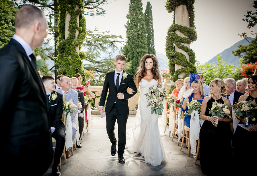 Bride-with-her-son-walking-down-the-aisle-at-Villa-Balbianello-by-My-Lake-Como-Wedding