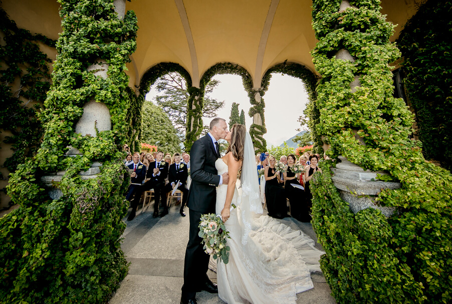 Wedding-kiss-under-the-arches-at-Villa-Balbianello-wedding-by-My-Lake-Como-Wedding
