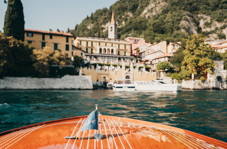 Bridal-boat-arriving-at-Varenna-for-Villa-Cipressi-wedding-organised-by-planner-My-Lake-Como-Wedding