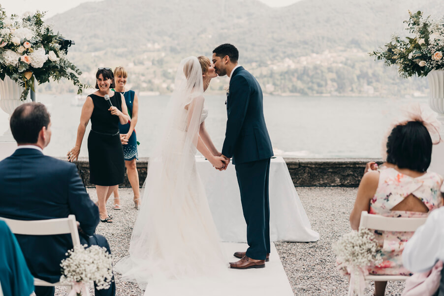 Bride-and-groom-kiss-at-their-wedding-on-Lake-Como-Villa-Carlotta