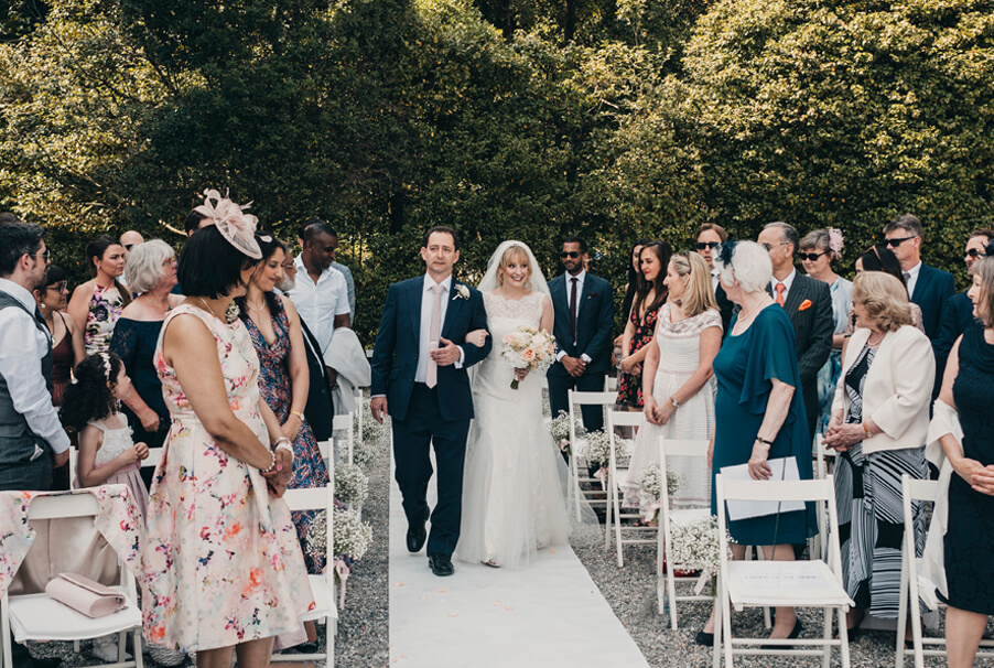 Bride-at-Villa-Carlotta-walking-the-aisle-with-her-father