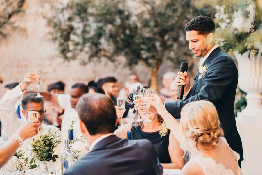 Groom-raising-a-toast-on-his-wedding-day-at-Villa-Cipressi-in-Varenna
