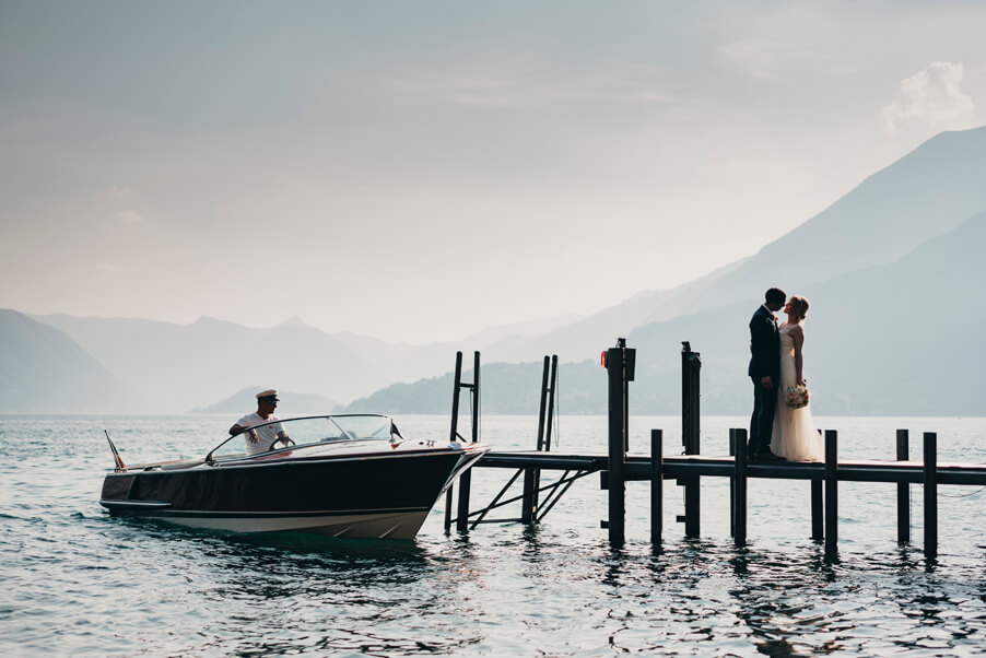 Lake-Como-wedding-with-bride-and-groom-on-pontoon-with-boat-a-view-organised-by-My-Lake-Como-Wedding