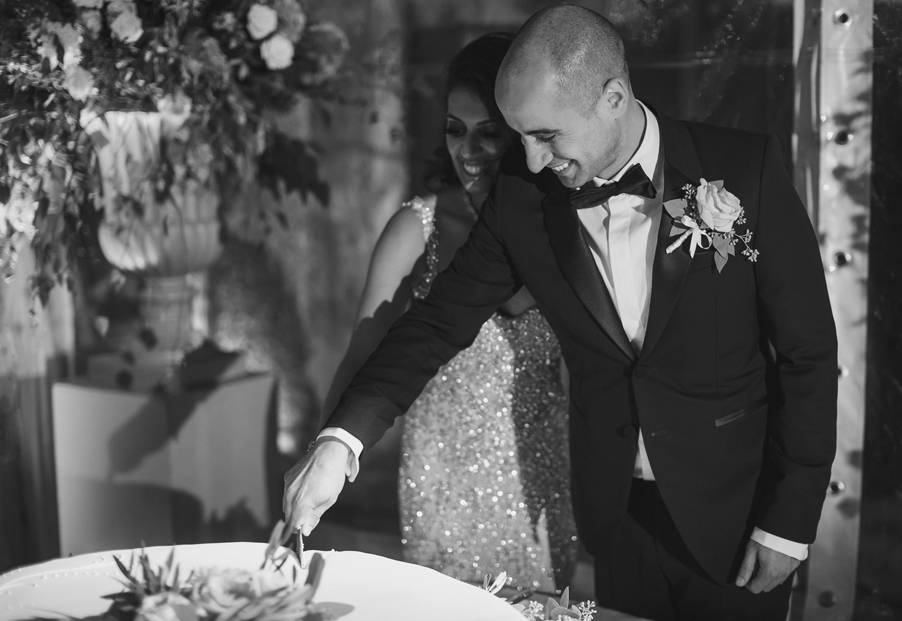 Bride-and-groom-cut-their-wedding-cake-at-Villa-Pizzo-wedding-by-My-Lake-Como-Wedding