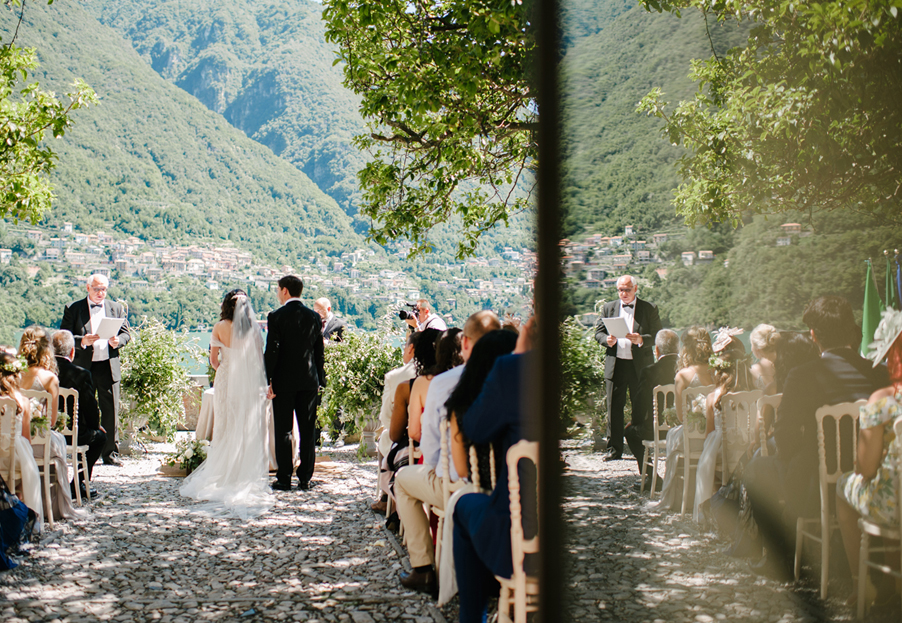 Reflection-image-of-ceremony-taking-place-on-Lake-Como