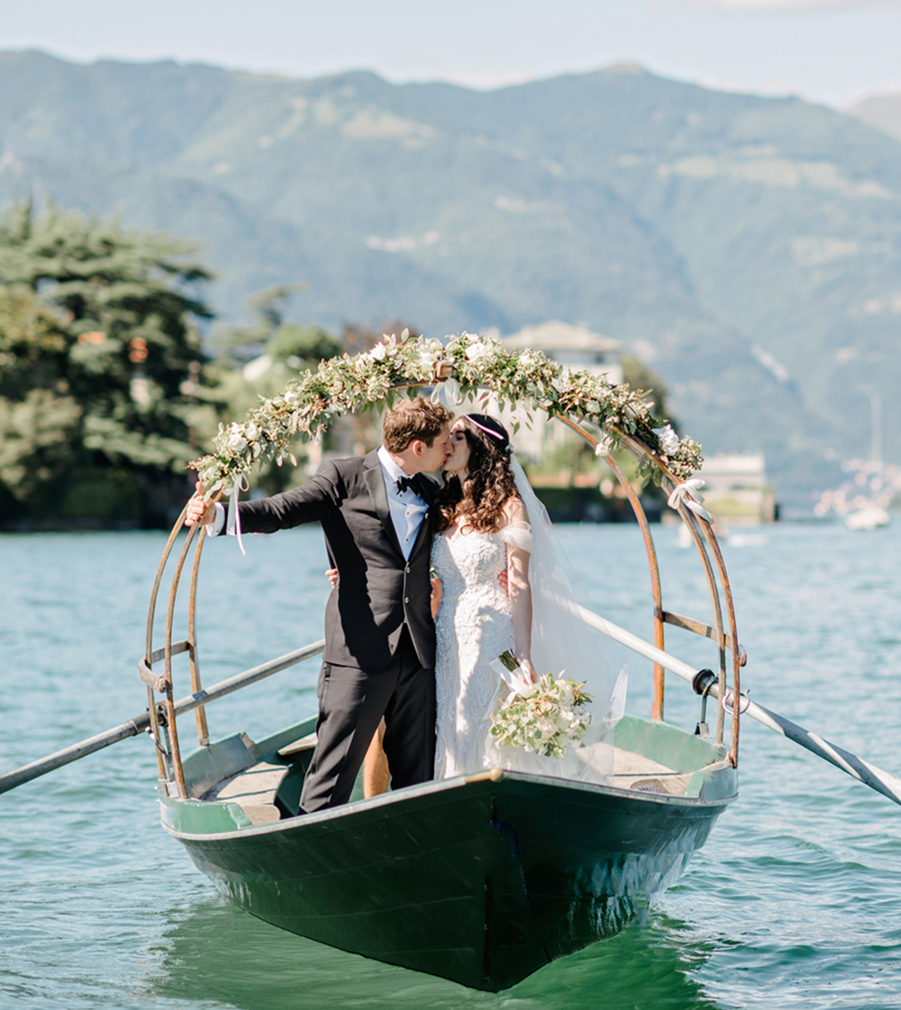 Bride-and-groom-on-Lucia-row-boat-on-Lake-Como