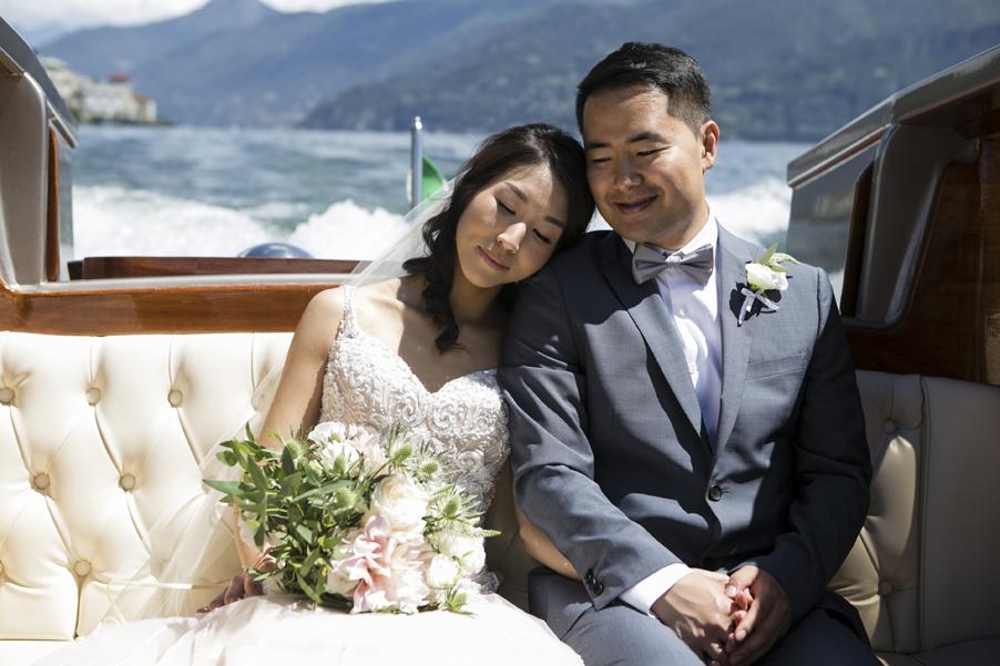 Bride-and-groom-on-boat-on-Lake-Como-photoshoot