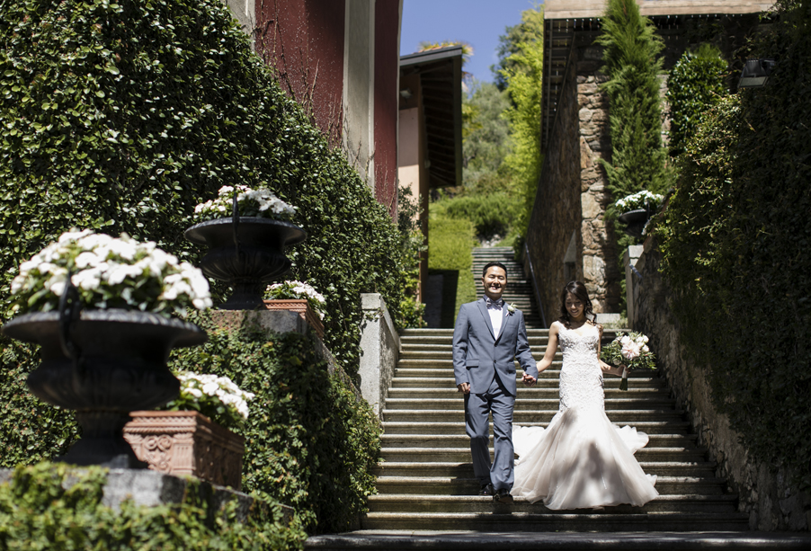 Bride-and-groom-on-villa-stairs-on-Lake-Como