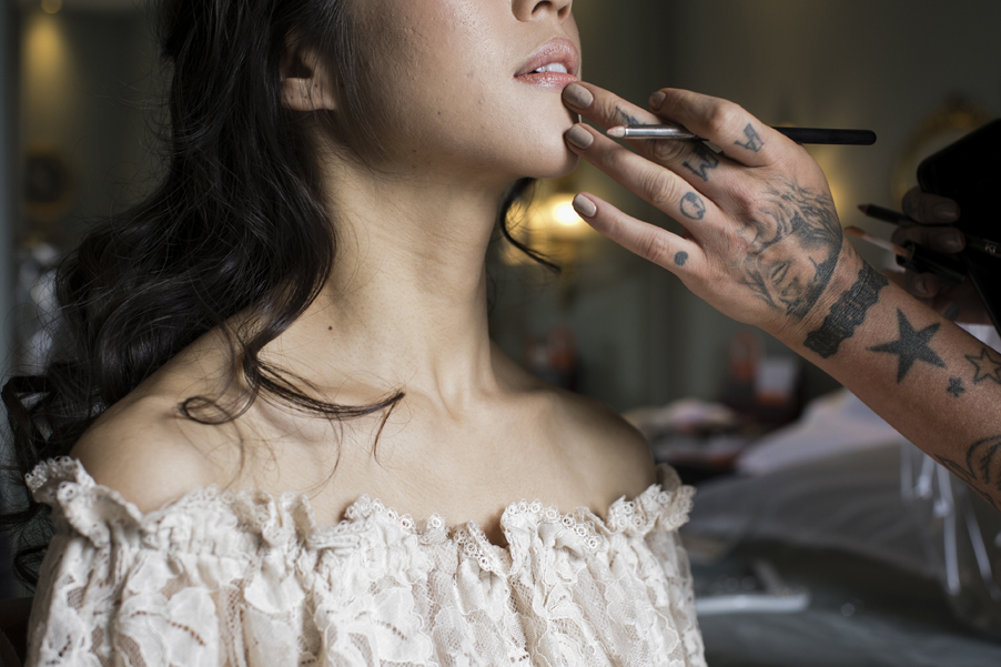 Bride-having-makeup-for-wedding-photoshoot-on-Lake-Como