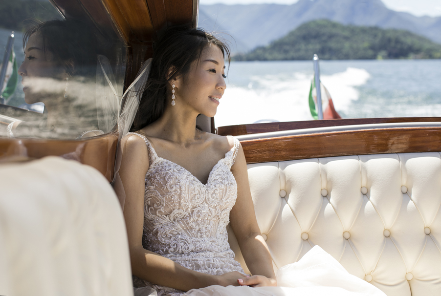 Bride-on-speed-boat-on-the-way-to-her-wedding-on-Lake-Como-photoshoot-by-My-Lake-Como-Wedding