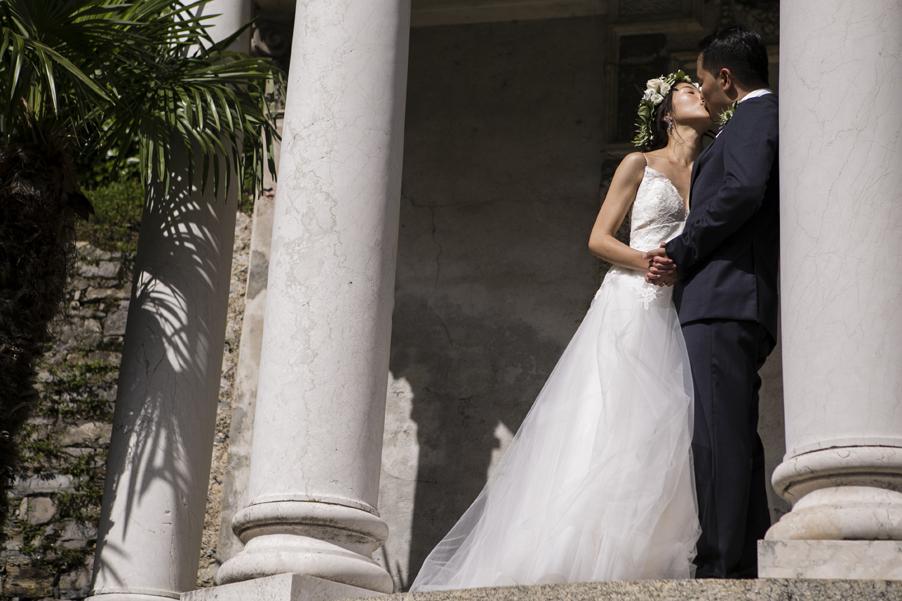 Bride-and-groom-kissing-at-their-Italian-wedding-villa-arranged-by-My-Lake-Como-Wedding