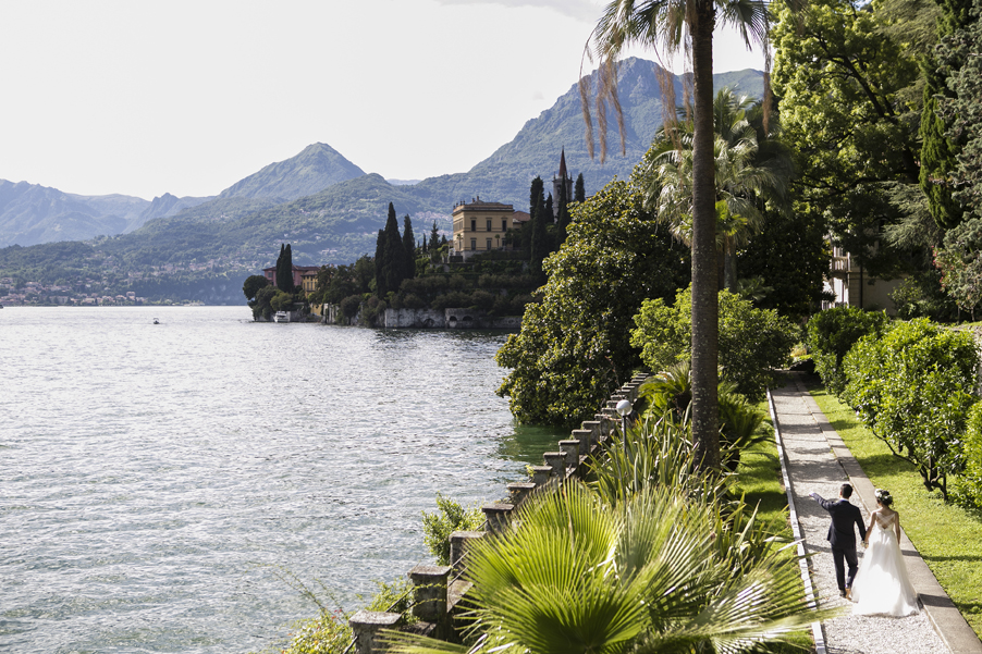 Bride-and-groom-walking-toward-their-wedding-venue-Villa-Cipressi-on-Lake-Como-arranged-by-My-Lake-Como-Wedding