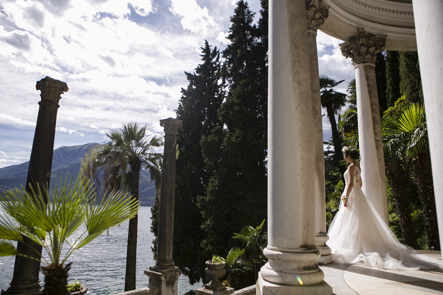 Italian-villa-photoshoot-with-bride-in-wedding-dress-looking-out-over-Lake-Como