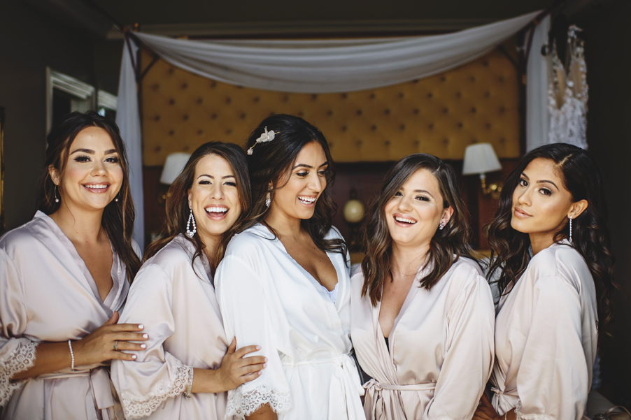 Bride-and-bridesmaids-together-in-hotel-room-ready-for-wedding-planner-My-Lake-Como-Wedding