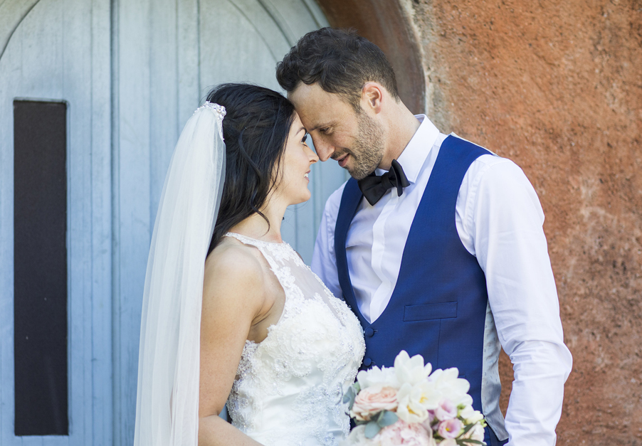 Bride-and-groom-in-dorrway-together-at-Villa-Regina-Teodolinda-on-Lake-Como