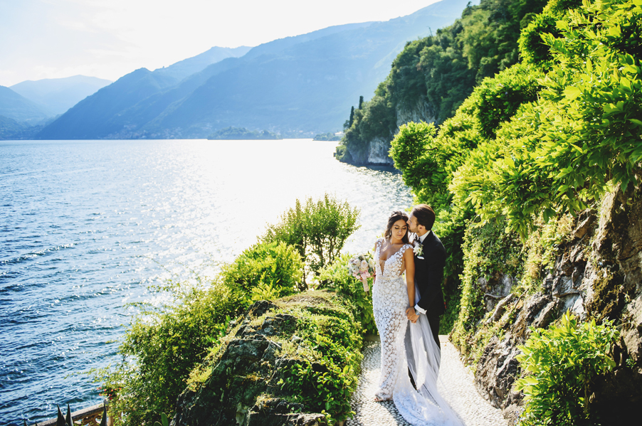 Bride-and-groom-pose-on-Lake-Como-at-Villa-Balbianello-planned-by-My-Lake-Como-Wedding