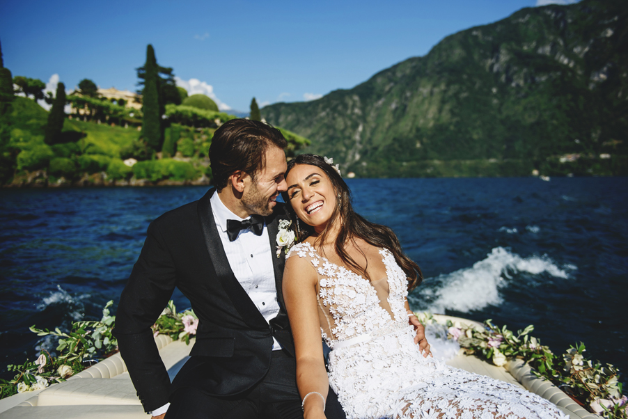 Bride-and-groom-with-wedding-flowers-on-their-speed-boat-by-wedding-planner-My-Lake-Como-Wedding