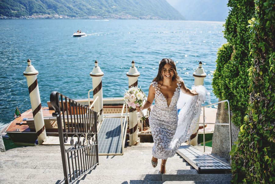 Bride-arriving-at-Villa-Balbianello-by-speed-boat-a-wedding-venue-for-My-Lake-Como-Wedding