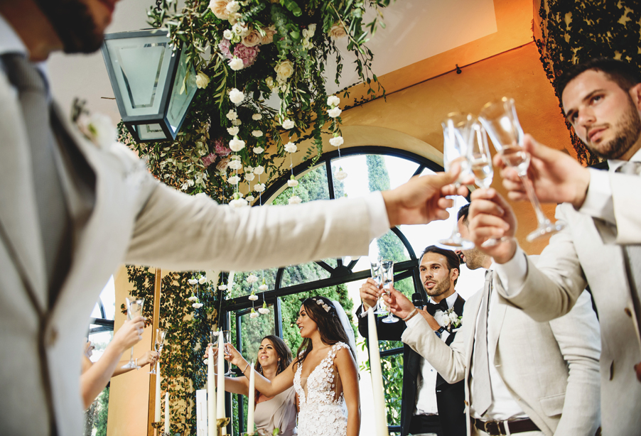 Everyone-raises-a-glass-of-champagne-to-the-bride-and-groom-in-Italy-wedding-planner-My-Lake-Como-Wedding