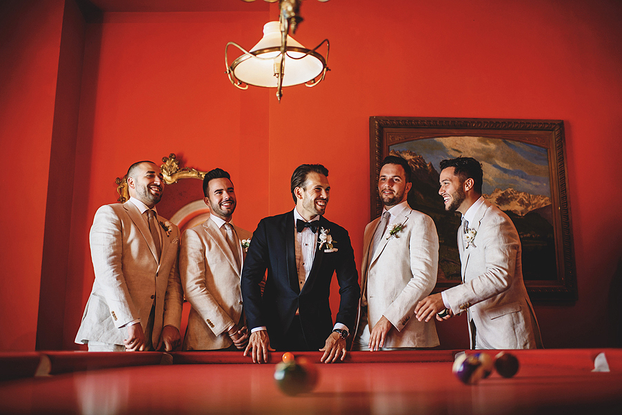 Groom-and-groomsmen-in-pool-room-at-hotel-before-wedding